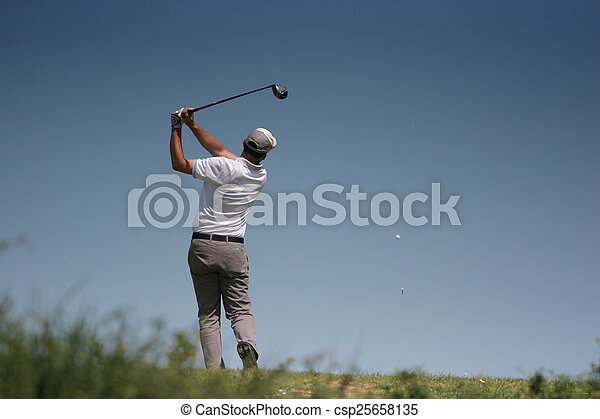 Man golf swing on a golf course - csp25658135