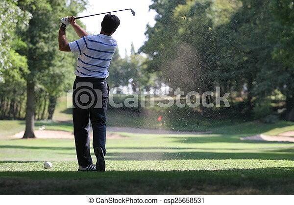 Man golf swing on a golf course - csp25658531