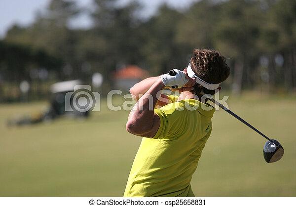 Man golf swing on a golf course - csp25658831