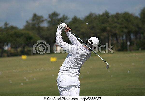Man golf swing on a golf course - csp25658937