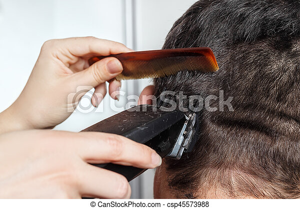 man haircut by clipper and comb - csp45573988