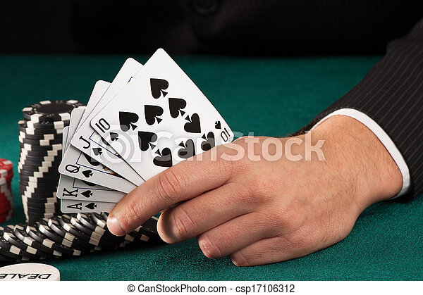 Man hand holding poker cards - csp17106312