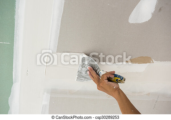 Man Hand With Trowel Plastering A Ceiling Skim Coating Plaster Walls