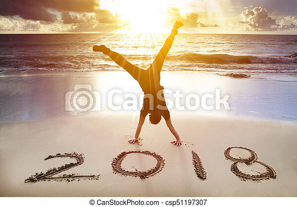 man handstand on the beachhappy new year 2018 concept csp51197307