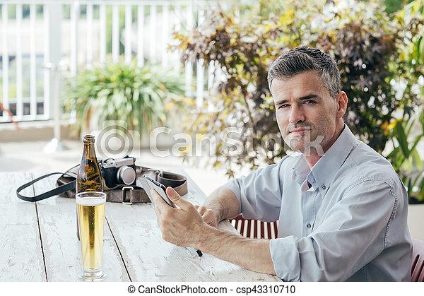 Man having a drink at the bar - csp43310710