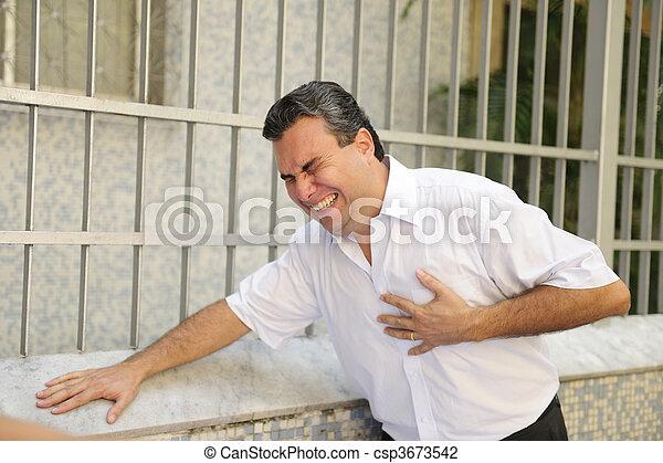 Man having a heart attack bending - csp3673542