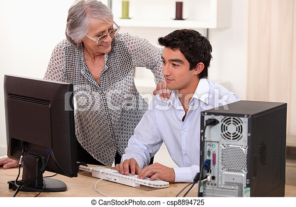 Man  helping elderly woman with computer problems - csp8894725