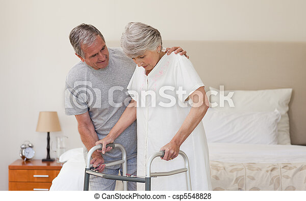 Man helping his wife to walk - csp5548828