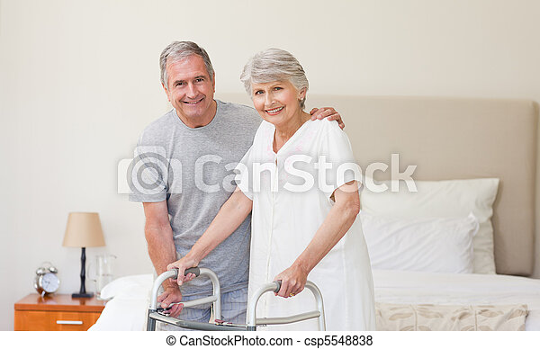Man helping his wife to walk - csp5548838