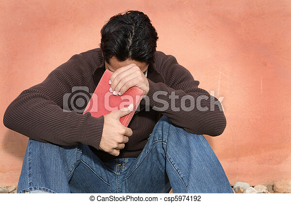 man holding, bible while praying - csp5974192