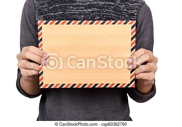 Man holding brown envelope - csp60362760