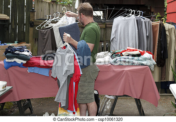 Man Holding Clothes at Sale - csp10061320