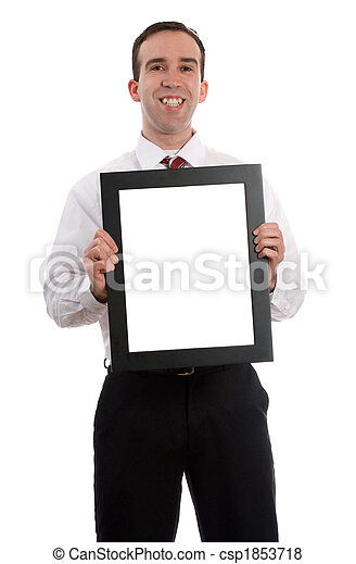Man holding frame. A young employee is holding up a frame with copy ...