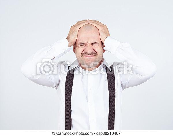 man holding his head pain. - csp38210407