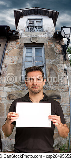 Man holding message by a house - csp26495652