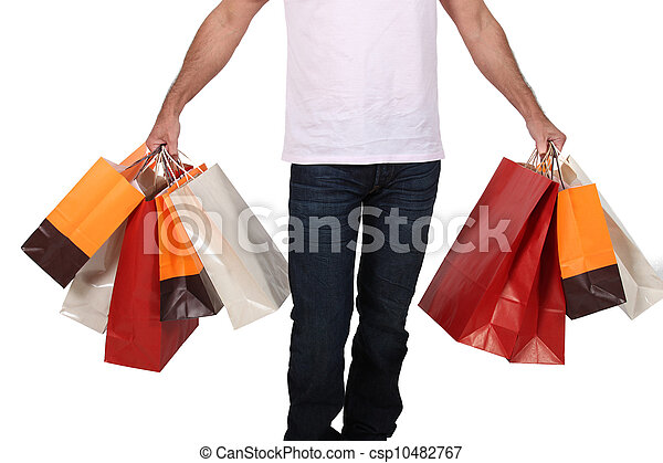 Man holding numerous shopping bags - csp10482767