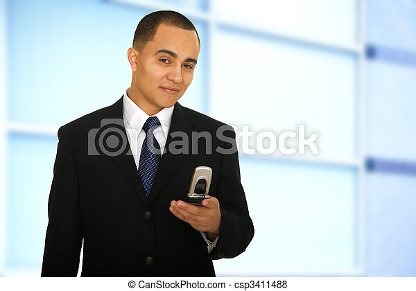 Man Holding Phone And Smile In Office - csp3411488