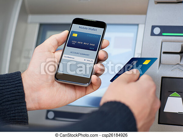 man holding phone with mobile wallet at the ATM - csp26184926