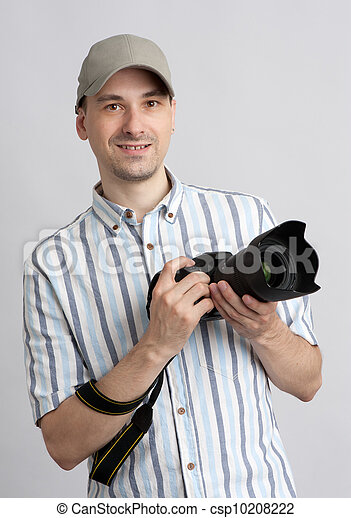 Man holding professional camera - csp10208222