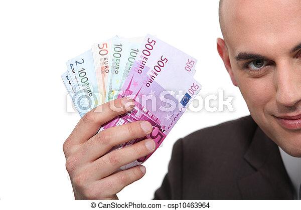 Man holding up banknotes - csp10463964