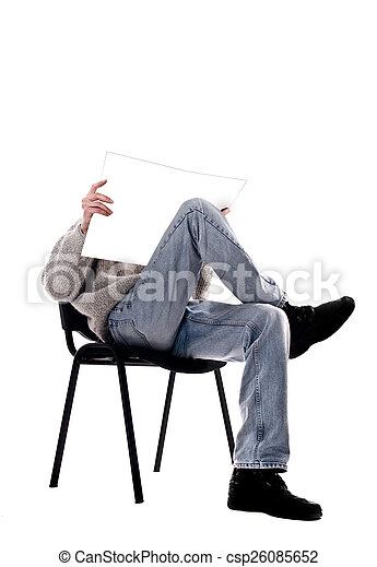 man in a chair with a magazine - csp26085652