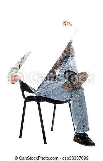 man in a chair with a magazine - csp33337099