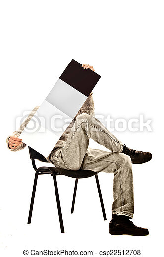 man in a chair with a magazine - csp22512708