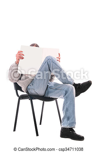 man in a chair with a magazine - csp34711038