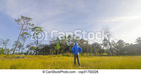 Man in a green field - csp31792228