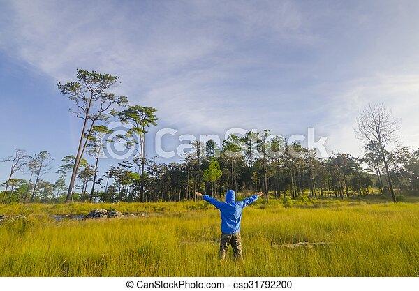 Man in a green field - csp31792200