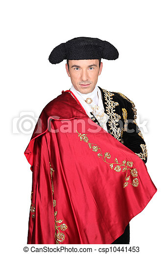 Man in a matador costume with a red cape - csp10441453