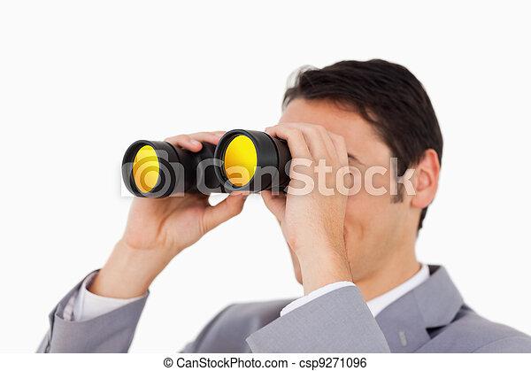 Man in a suit using binoculars  - csp9271096