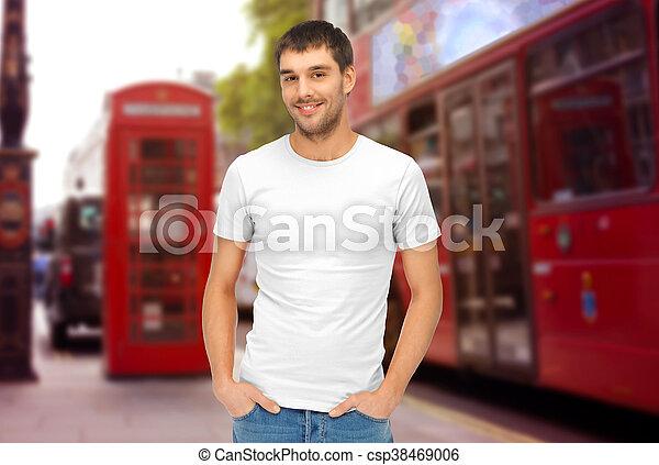 man in blank white t-shirt over london city street - csp38469006