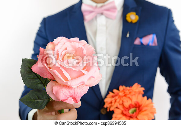 man in blue suit carry flowers - csp36394585