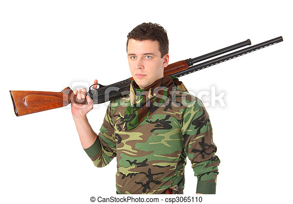 man in camouflage with gun on shoulder - csp3065110