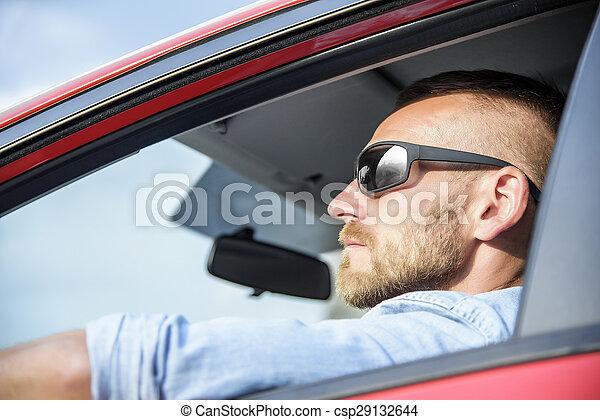 Man in car. - csp29132644