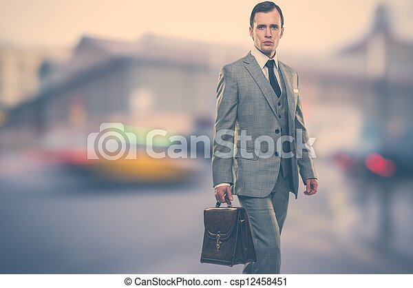 Man in classic grey suit with briefcase  outdoors - csp12458451