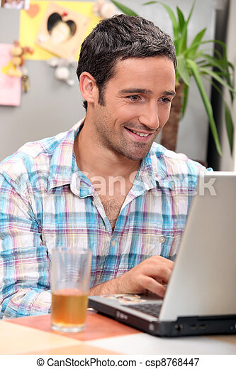 man in front of computer - csp8768447