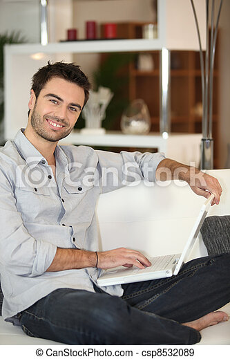 Man in front of computer - csp8532089
