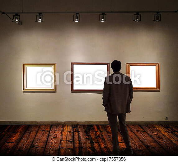 Man in gallery room looking at empty picture frames stock images ...