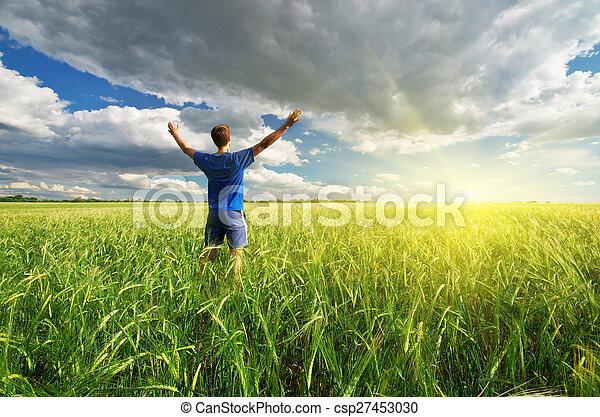 Man in green meadow. - csp27453030