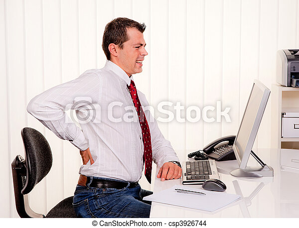 Man in office with computer and back pain - csp3926744