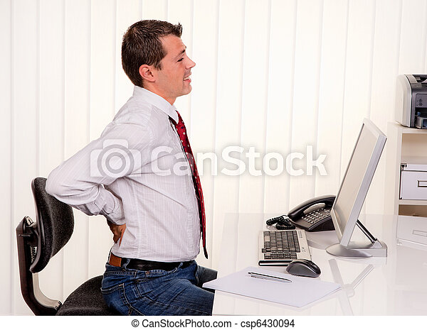 Man in office with computer and back pain - csp6430094