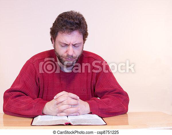 Man in red shirt praying. - csp8751225