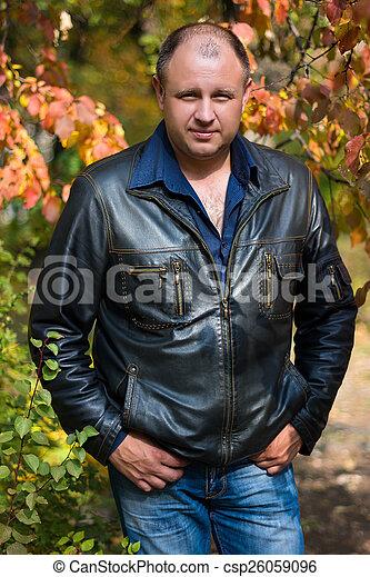 man in the autumn Park - csp26059096