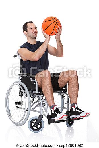 Man in wheelchair playing basketball - csp12601092