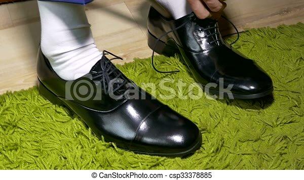Man in white dress socks to tie