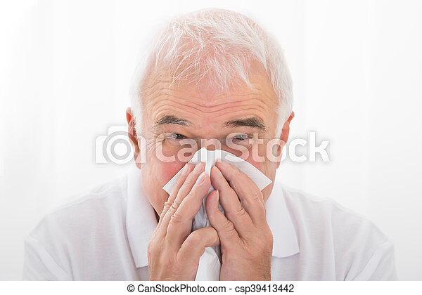 Man Infected With Cold Blowing His Nose - csp39413442