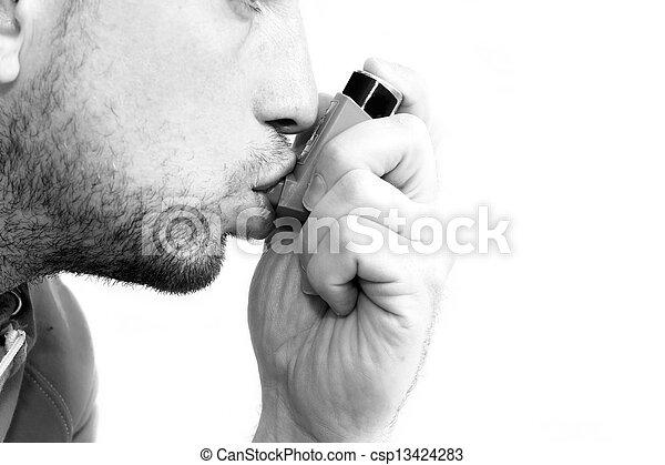man inhaling his asthma pump - csp13424283