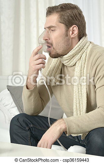 Man Inhaling Through Inhaler Mask - csp36159443